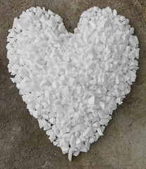 Background of little piles of scrap foam into a heart