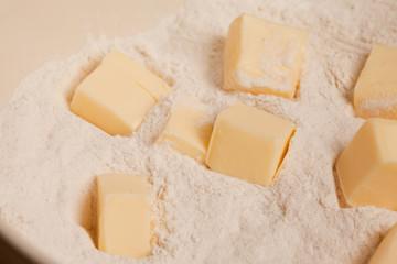 butter cubes in flour