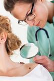 Dermatologist examining a mole poster