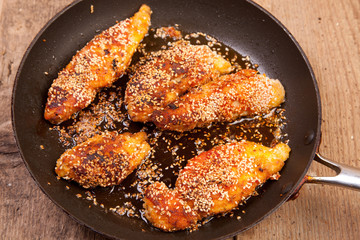 chicken breast with breadcrumbs and sezame seeds