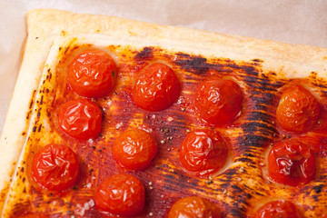 close up baked puff pastry with tomatos