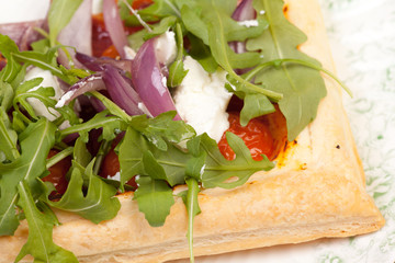 puff pastry with tomatos onions rocket salad and goats cheese