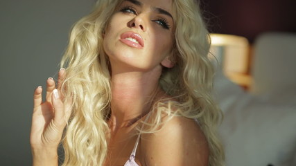 Seductive woman with long blond hair