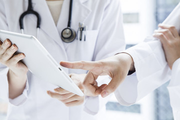 Doctor pointing at tablet