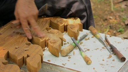 Close up wood carver working.