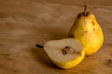 Pear on a rustic wooden table
