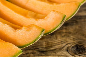 Melon slices on a rustic wooden table