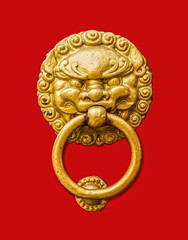 Metal door knocker in Chinese design isolated on red background