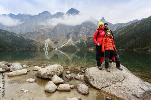 canvas print picture Hiking, trekking - tourist on mountain trek