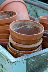 Stack of used terra cotta flower pots