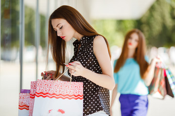 beautiful girl with shopping bags in a mall