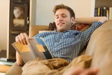 Young man reading on his couch