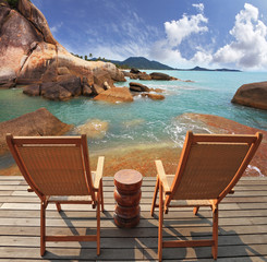 Two guest sun loungers on a wooden platform