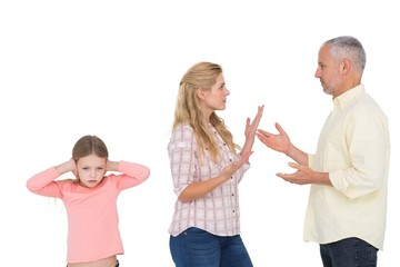 Parents arguing beside their upset daughter
