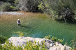 Upper view of fly fisherman fly-fishing in river