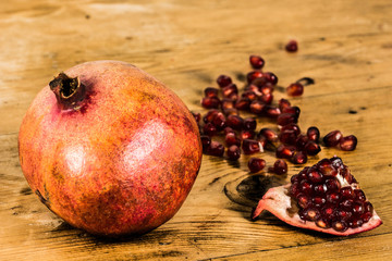Organic pomegranate on a wooden table