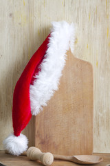 Christmas cooking abstract background with santa claus hat
