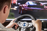 Teen playing in the race behind the wheel - 70881123