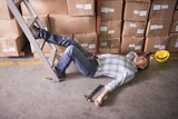 Worker lying on the floor in warehouse