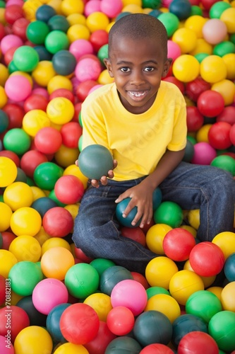 canvas print picture Cute boy smiling in ball pool