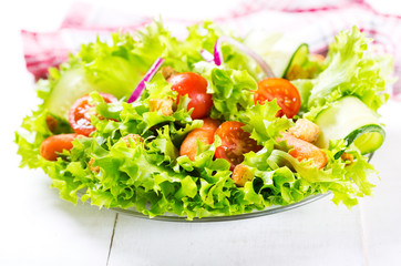 plate of fresh salad with vegetables