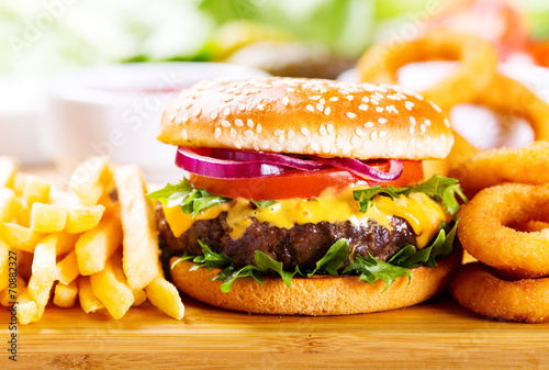 hamburger with fries and onion rings - 70882327