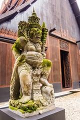 Guardian statue in Baan Dam Temple, Chiang Rai, Thailand