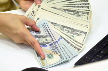 100 US dollar money in hand