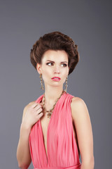Stylish Lady in Pink Dress with Ornamentation