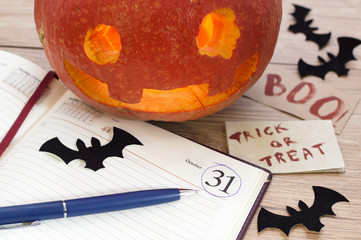 Pumkin head with bats, diary and pencil