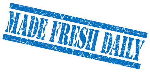 made fresh daily blue grungy stamp on white background