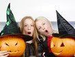 canvas print picture - Young girls with pumpkins