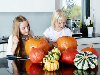 Young girls with pumpkins