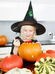 Girl preparing pumpkin for Hallween