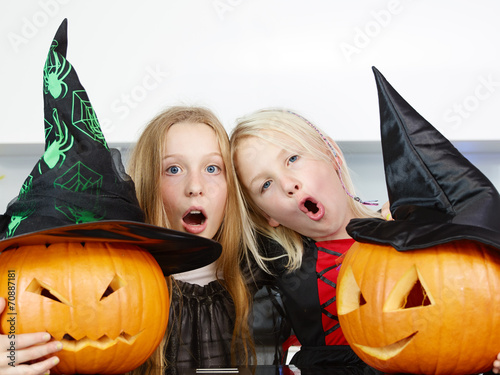 canvas print picture Young girls with pumpkins