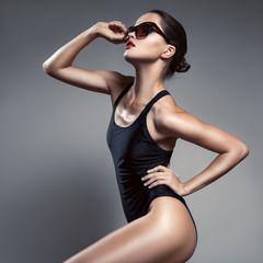 Fashion woman. Bikini and sunglasses.