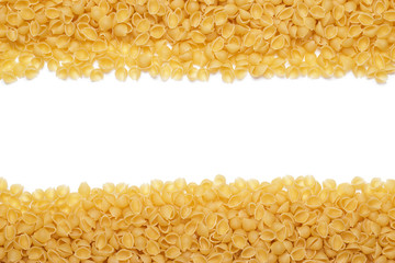 uncooked macaroni background with copy space