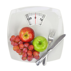 Fresh fruit on a plate with weighing scale
