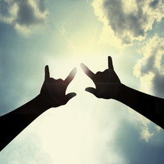 Hand sign I love you in sky