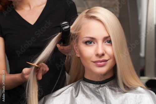 canvas print picture closeup on happy young woman getting new haircut by hairdresser