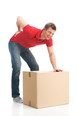 man dressed in casual clothing hurt his back lifting large box.