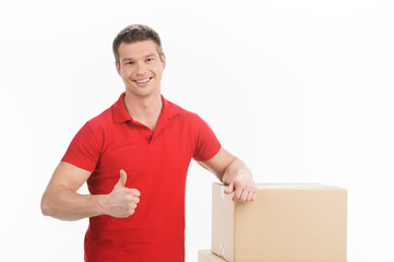 man leaning on boxes isolated over white background.