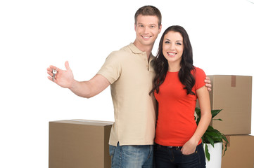 couple celebrating new home with keys