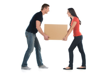 Beautiful young couple holding big heavy box.