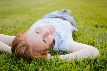 Woman Lying on Green Grass