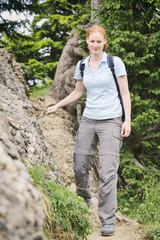Hiker on a Narrow Mountain Trail