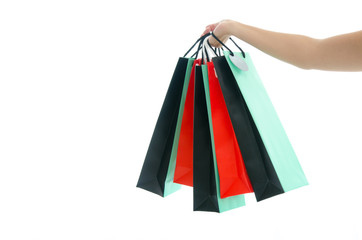 Woman hand holding shopping bag on white background