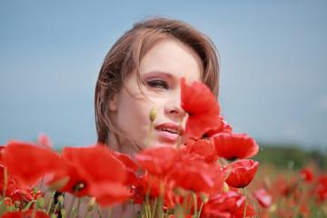 Beautiful Girl in the poppy field, black dress