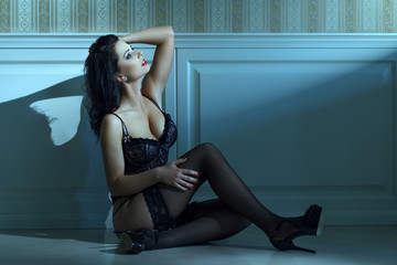 Sexy woman sit on the floor at night