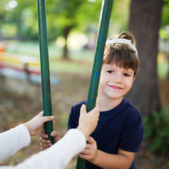 Little boy sit on swing